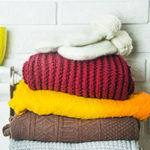 Pile of warm winter sweaters