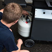 Checking propane grill cylinder